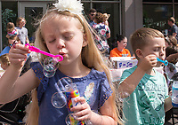 NWA Democrat-Gazette/CHARLIE KAIJO Lily Severs, 5, of Bella Vista (from left) and Alex Winchester, 5, of Pea Ridge blow bubbles, Saturday, May 12, 2018 at the Town Square in Bentonville. <br />