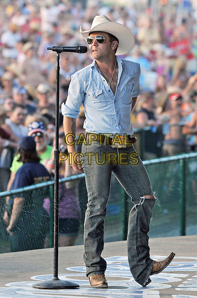 "Justin Moore.The 35th Anniversary of ""Jamboree In The Hills 2011"" also known as the ""Super Bowl of Country Music"", Morristown, Ohio, USA..July 14th, 2011.stage concert live gig performance music full length blue shirt sunglasses jeans denim  singing shades beige stetson cowboy hat .CAP/ADM/JN.©Jason L Nelson/AdMedia/Capital Pictures."