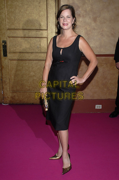 """MARCIA GAY HARDEN.Van Cleef & Arpels Hosts """"Une Journee A Paris"""" at the Hammerstein Ballroom, New York, New York, USA..September 4th, 2007.full length black dress gold pointy shoes clutch purse hand on hip .CAP/ADM/BL.©Bill Lyons/AdMedia/Capital Pictures *** Local Caption ***"""
