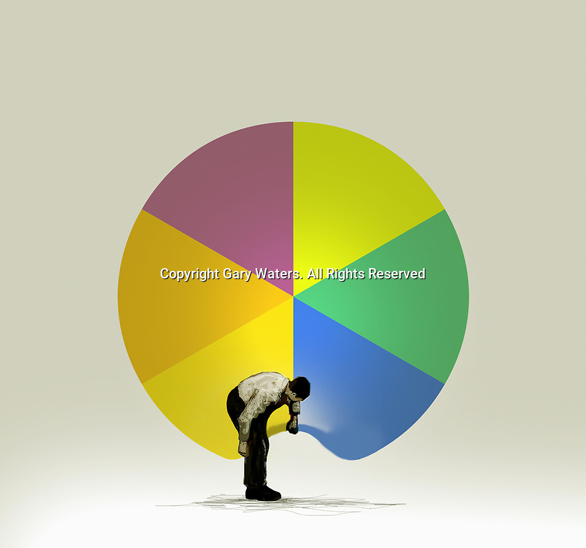 Man lifting up and looking under pie chart