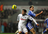 Pictured L-R: Branislav Ivanovic of Chelsea against Danny Graham of Swansea. Tuesday, 31 January 2012<br />