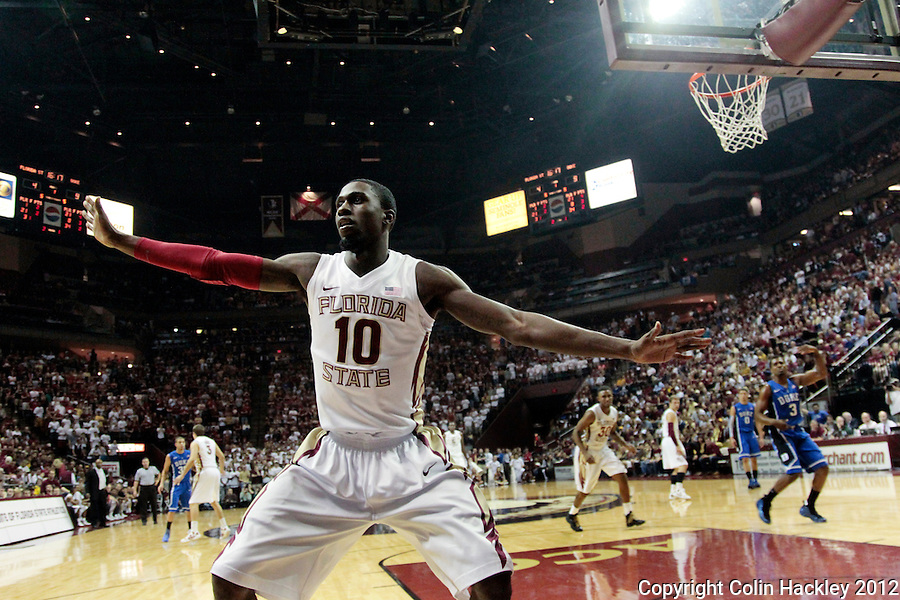 TALLAHASSEE, FLA. 2/23/12-FSU-DUKE022312 CH-FSU's Okaro White tries to prevent Duke from passing inbounds during first half action Feb. 23, 2012 in Tallahassee..COLIN HACKLEY PHOTO