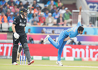 Jasprit Bumrah (India) in action as Martin Guptill (New Zealand) backs up during India vs New Zealand, ICC World Cup Semi-Final Cricket at Old Trafford on 9th July 2019