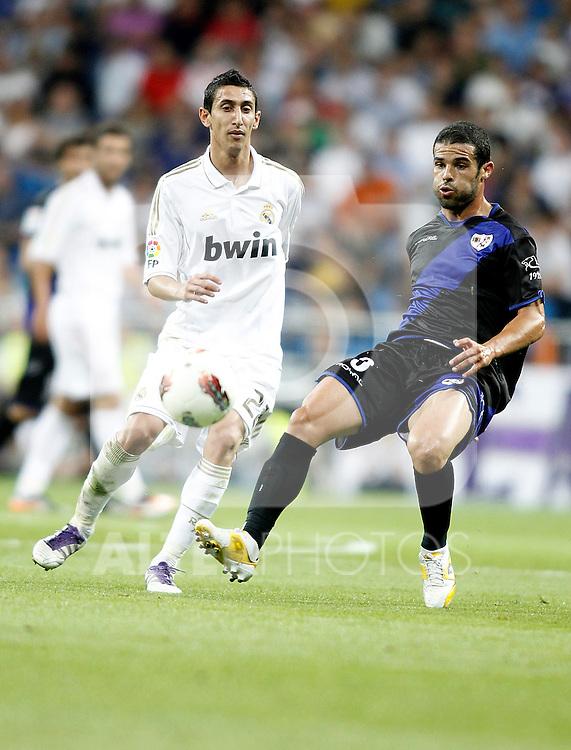Real Madrid's Angel Di Maria against Rayo Vallecano's Andrija Delibasic during La Liga Match. September 24, 2011. (ALTERPHOTOS/Alvaro Hernandez)