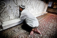 Kashmri muslim man cries as he prays at a shrine of a sufi saint in Srinagar as the main duty to observe the holy month of Ramadan. As the tradition is attended muslims has to fast from dawn to dusk, where they refrain from eating, drinking and smoking.