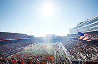 The Ohio State Buckeyes run on to the field before the college football game between the Ohio State Buckeyes and the Illinois Fighting Illini at Memorial Stadium in Champaign, Ill., Saturday morning, November 14, 2015. As of half time the Ohio State Buckeyes led the Illinois Fighting Illini 14 - 3. (The Columbus Dispatch / Eamon Queeney)
