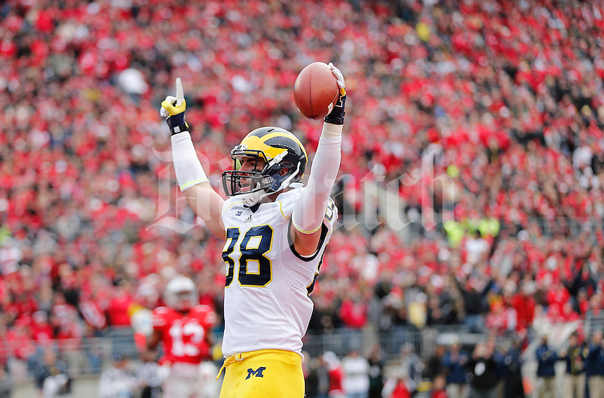 Michigan Wolverines tight end Jake Butt (88) celebrates his touchdown in the first quarter the college football game between the Ohio State Buckeyes and the Michigan Wolverines at Ohio Stadium in Columbus, Saturday morning, November 29, 2014. As of half time the Ohio State Buckeyes and Michigan Wolverines were tied 14 - 14. (The Columbus Dispatch / Eamon Queeney)