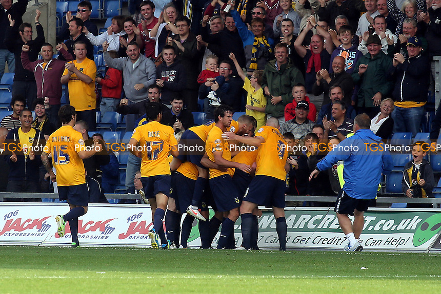 Oxford players celebrate after scoring an injury time equaliser - Oxford United vs Wycombe Wanderers - Sky Bet League Two Football at the Kassam Stadum, Oxford - 24/08/13 - MANDATORY CREDIT: Paul Dennis/TGSPHOTO - Self billing applies where appropriate - 0845 094 6026 - contact@tgsphoto.co.uk - NO UNPAID USE
