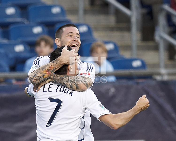 Vancouver Whitecaps FC forward Eric Hassli (29) celebrates goal with assist by Vancouver Whitecaps FC forward Sebastien Le Toux (7).  In a Major League Soccer (MLS) match, the New England Revolution defeated Vancouver Whitecaps FC, 4-1, at Gillette Stadium on May 12, 2012.