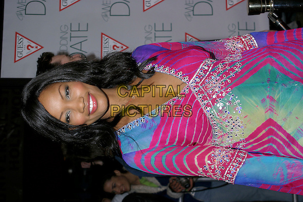 "GARCELLE BEAUVAIS-NILON.The World Premiere of ""The Wedding Date"" held at the Universal Studios Cinema, Universal City, California,USA,.27 January 2005..half length pink blue green patterned printed long sleeved  top.Ref: ADM.www.capitalpictures.com.sales@capitalpictures.com.©JWong/AdMedia/Capital Pictures ."