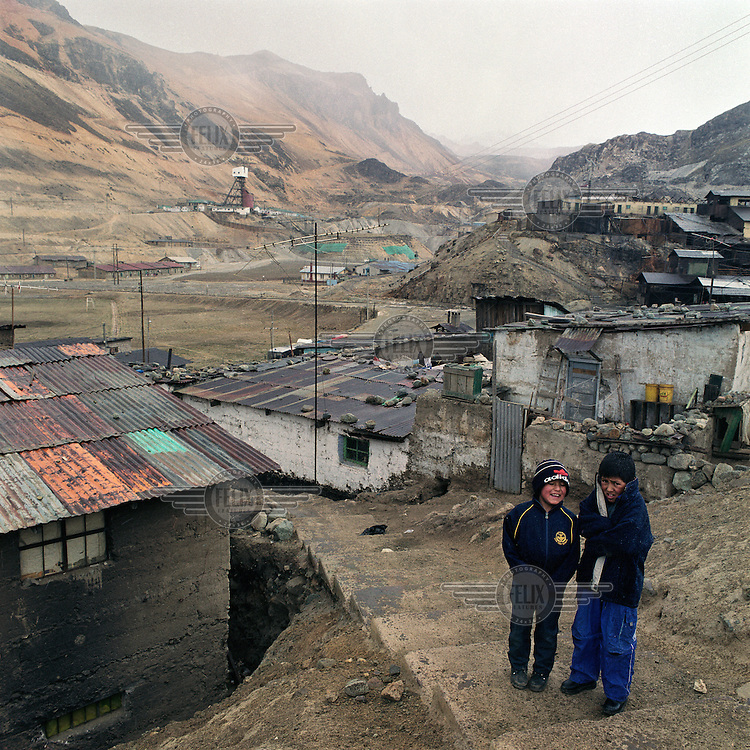 Two boys in cold weather.  Many children who live locally have traces of lead in their blood.  The mining village of Morococha is 4,600 meters above sea level and produces silver, copper, lead and zinc.  6,500 inhabitants work for the American mining company Pan American Silver and the Austrian company Austria Duvaz.