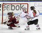 Allie Thunstrom (Boston College - 9), Leah Sulyma (Northeastern - 1), Erin Reil (Northeastern - 19) - The Boston College Eagles defeated the Northeastern University Huskies 3-1 in the opening round of the Beanpot on Tuesday, February 3, 2009, at Matthews Arena in Boston, Massachusetts.