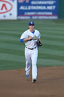 Brandon Dixon (9) of the Rancho Cucamonga Quakes returns to the dugout during a game against the High Desert Mavericks at LoanMart Field on August 3, 2015 in Rancho Cucamonga, California. Rancho Cucamonga defeated High Desert, 2-1. (Larry Goren/Four Seam Images)