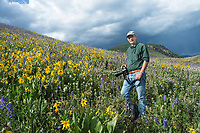 Richard in wild flowers near Crested Butte