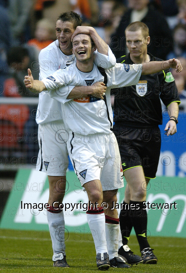 30/10/2004  Copyright Pic : James Stewart.File Name : jspa14_dundee utd v dunfermline.DARREN YOUNG IS CONGRATULATED BY ANDY TOD AFTER SCORING DUNFERMLINE'S LATE WINNER.....Payments to :.James Stewart Photo Agency 19 Carronlea Drive, Falkirk. FK2 8DN      Vat Reg No. 607 6932 25.Office     : +44 (0)1324 570906     .Mobile  : +44 (0)7721 416997.Fax         :  +44 (0)1324 570906.E-mail  :  jim@jspa.co.uk.If you require further information then contact Jim Stewart on any of the numbers above.........