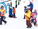 Children learning snowboarding and skiing at Blue Mountain, Collingwood, Ontario, Canada ski resort.