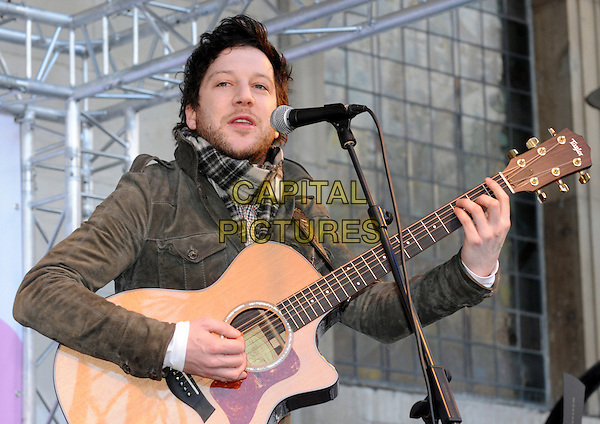 Matt Cardle.BBC Children In Need's Pudsey Street -photocall, New Piazza, Covent Garden, London, England..3rd November 2012.on stage in concert live gig performance performing music half length grey gray guitar jacket white scarf plaid tartan stubble facial hair singing .CAP/PP/BK.©Bob Kent/PP/Capital Pictures