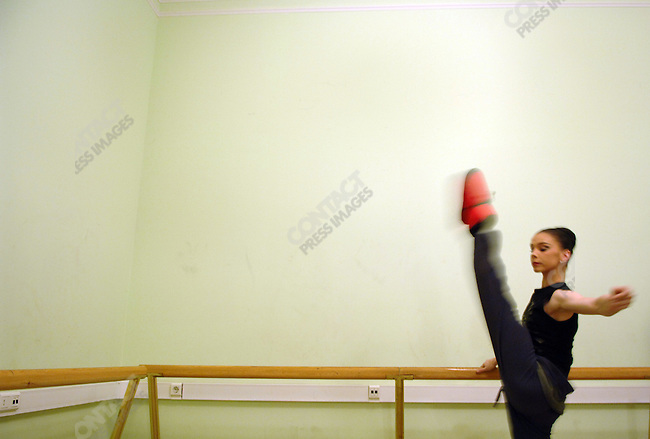 Nataliya Osipova, a soloist at the Bolshoi, warmed up next to the stage before her performance in Les Presages by Massine at the Bolshoi Theatre's New Stage. Moscow, Russia, January 25, 2007
