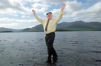 TITLE; 'All Powerfull'<br /> <br /> Jackie Healy-Rae can really walk on water. This is not a trick image as the deputy is actually walking on water....it's only three inches deep!,<br /> <br /> One of the images from Don MacMonagle's book of 100 photographs of Deputy Jackie Healy-Rae entitled 'Jackie - Keeping Up Appearance'.<br /> <br /> Picture by Don MacMonagle