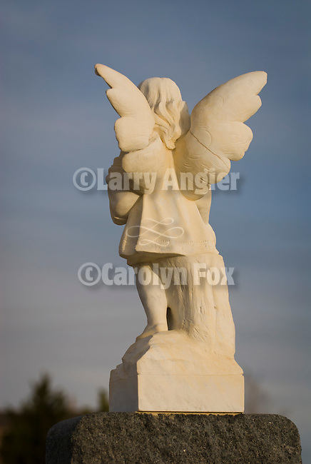 Angel headstone at sundown in the Tonopah Cemetery.