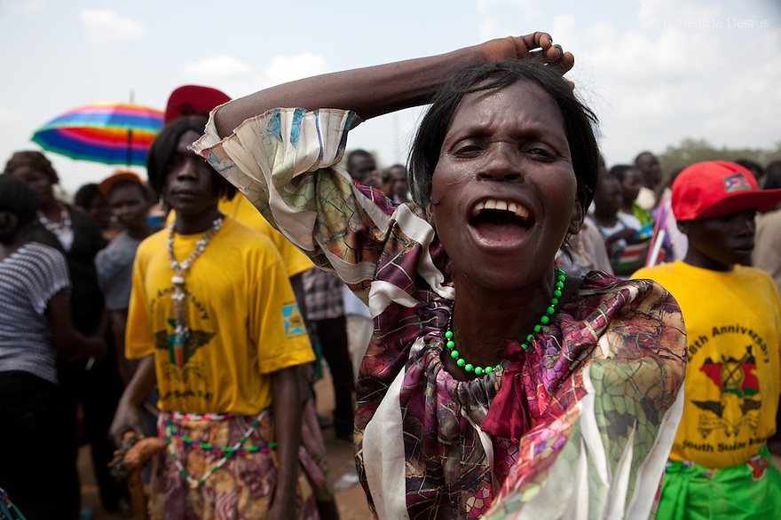 Saturday 9 july 2011 - Juba, Republic of South Sudan - A South Sudanese woman chant and dance during South Sudan's independence day celebrations in Juba. Tens of thousands of citizens of the new South Sudan celebrate national independence but whether statehood will resolve issues of identity after a decades-long war remains to be seen. Photo credit: Benedicte Desrus