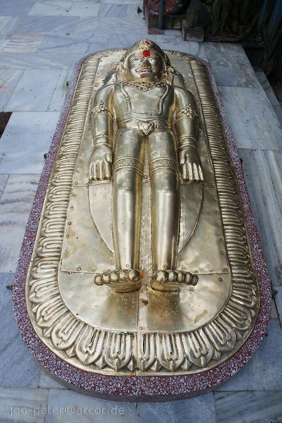 golden statue of sleeping Vishnu in Pancha Nadi  temple near  ghats of river Bagmati, Kathmandu, Nepal