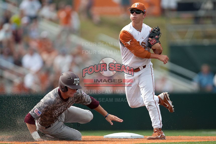 Texas Longhorns second baseman Brooks Marlow #8 turns a double play during the NCAA baseball game against the Texas A&M Aggies on April 29, 2012 at UFCU Disch-Falk Field in Austin, Texas. The Longhorns beat the Aggies 2-1 in the last ever regular season game scheduled for the long time rivals. (Andrew Woolley / Four Seam Images).