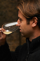 Philippe Viret tasting a barrel sample of fermenting white wine.  Domaine Viret, Saint Maurice sur Eygues, Drôme Drome France, Europe