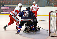 Ben Osborne (L) stabs the puck home for the second goal for Haringey during the National Ice Hockey League South Division 2 Cup - Group B game between Haringey Racers and Slough Jets at Alexandra Palace, London on Sat Sept 13, 2014.