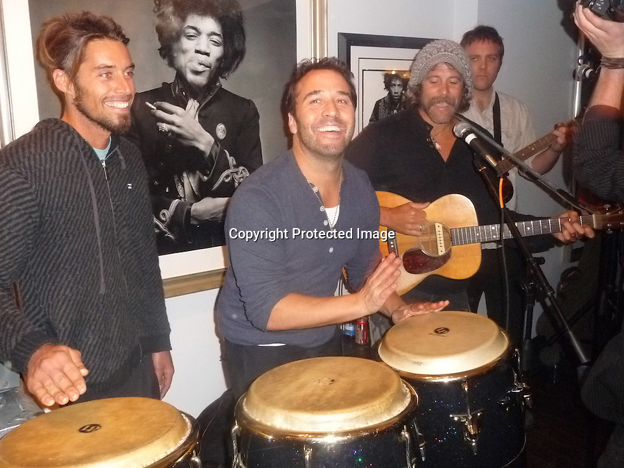 2-17-2010.Exclusive ...Jeremy Piven played the drums with pro surfer Donovan Frankenreiter's band at the Celebrities Arts gallery in Beverly Hills. He performed one song with the band. He was really really good....AbilityFilms@yahoo.com.805-427-3519.www.AbilityFilms.com