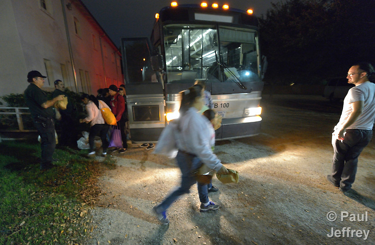 Benito Miller (right) receives women and children upon their release from detention by U.S. immigration authorities in San Antonio, Texas, on December 2, 2015. The women fled violence in Central America with their children and were detained upon their arrival in the United States. When released, they were transported to San Antonio by bus, then Miller took them to a shelter run by the Refugee and Immigrant Center for Education and Legal Services (RAICES) and supported by a coalition of San Antonio churches. Shelter staff and volunteers help the women and children with food, clothing and a secure place to sleep until they can make arrangements for travel onward to stay with relatives elsewhere in the U.S., pending a final decision on their request for asylum. Miller is co-coordinator of the shelter.