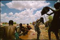 Wajid, Somalia, March 2006.Boys wash near a water well in Wajid.