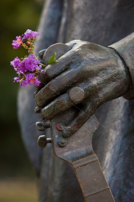 Closeup of Austin's Stevie Ray Vaughan Statue with flowers in hand