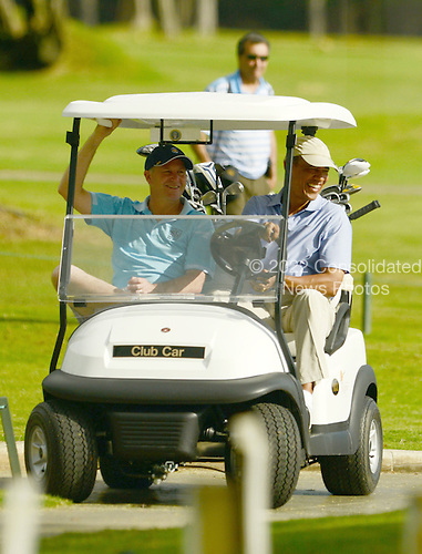 United States President Barack Obama rides with Prime Minister John Key of New Zealand while golfing at the Marine Corps Base Hawaii's Kaneohe Klipper Golf Course, Kaneohe, Hawaii, January 2, 2014. <br /> Credit: Cory Lum / Pool via CNP