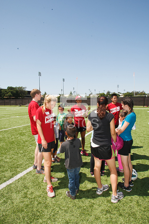 STANFORD-- April 21, 2013: Stanford athletes share their love of sports and staying active with kids on campus for field day.