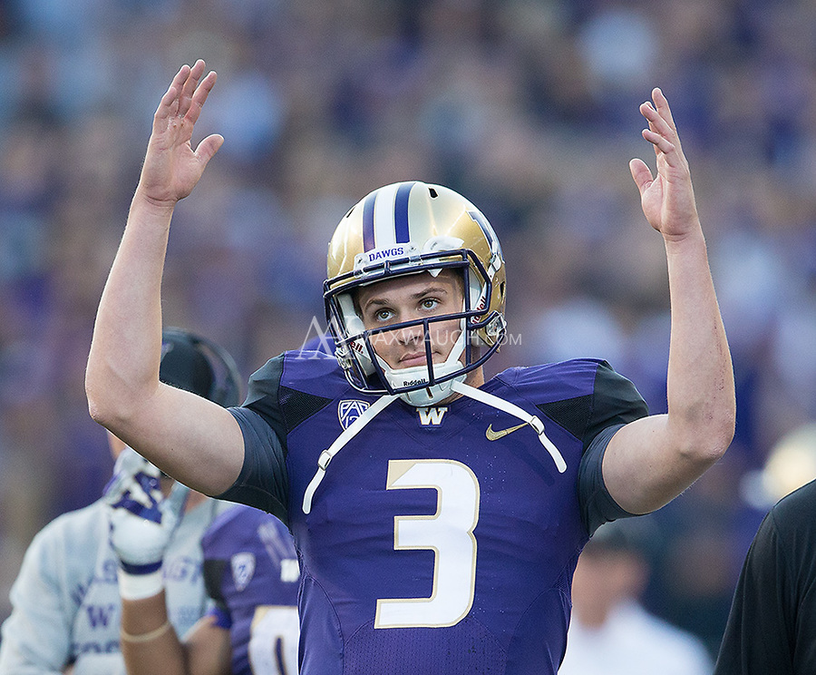 Jake Browning knows the touchdown was good while waiting for an official review.