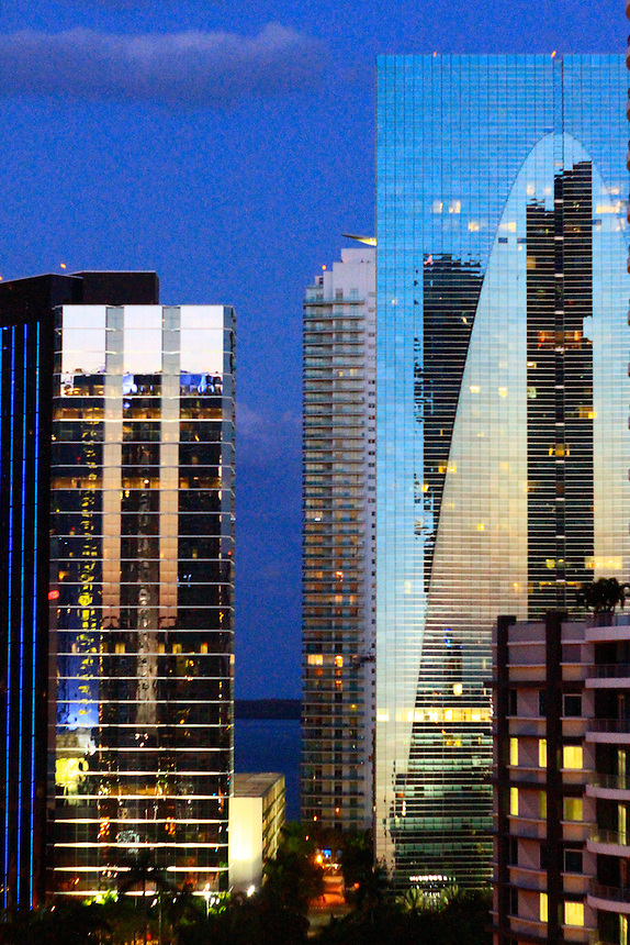 DUsk setting over the blue sky  in illuminated by the blue neon in Miami Brickell area with the stunning  Dimple building Esperitos des Santos Bank