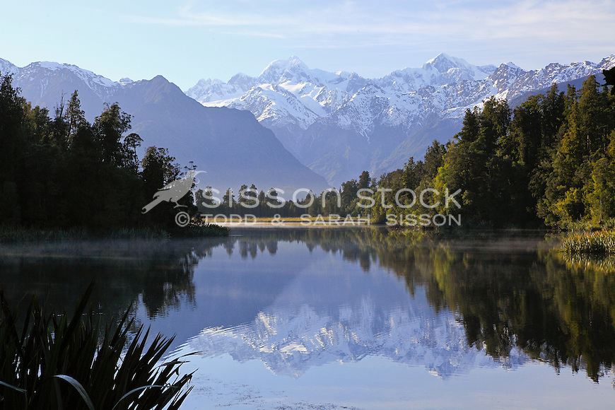 Iconic reflection of Mount Cook / Aoraki and Mount Tasman in Lake Matheson, Westland National Park, South Island, New Zealand