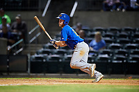 Midland RockHounds designated hitter Brett Vertigan (17) follows through on a swing during a game against the Arkansas Travelers on May 25, 2017 at Dickey-Stephens Park in Little Rock, Arkansas.  Midland defeated Arkansas 8-1.  (Mike Janes/Four Seam Images)
