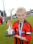 Thomas O'Connell of Drogheda Town FC under 11 with the winning trophy at the Drogheda and District schoolboys cup finals in Hunky Dorys park. Photo: Colin Bell/pressphotos.ie