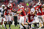 Wisconsin Badgers linebacker Conor O'Neill (13) celebrates a recovered fumble during an NCAA Big Ten Conference college football game against the Penn State Nittany Lions on November 26, 2011 in Madison, Wisconsin. The Badgers won 45-7. (Photo by David Stluka)