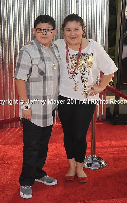 """UNIVERSAL CITY, CA - OCTOBER 02: Rico Rodriguez and Raini Rodriguez attend the """"Real Steel"""" Los Angeles Premiere at Gibson Amphitheatre on October 2, 2011 in Universal City, California."""