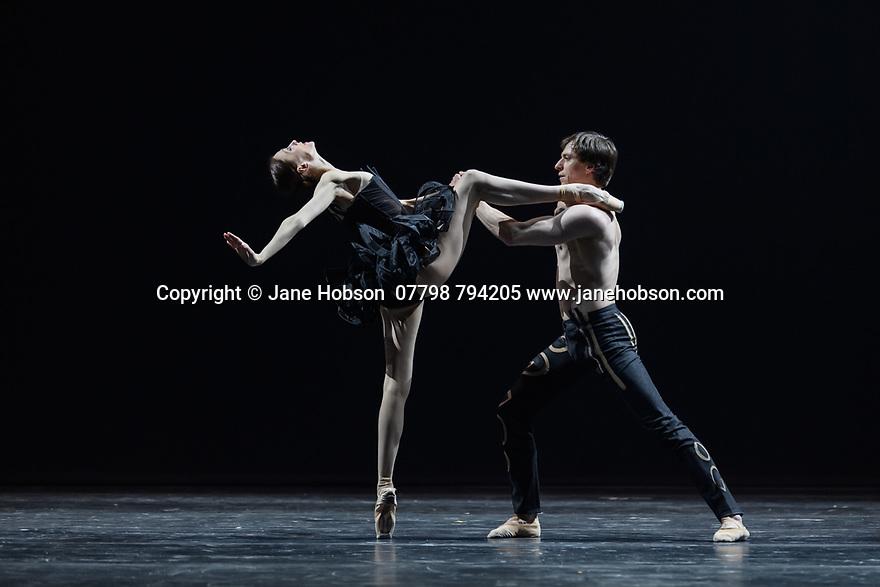 "London, UK. 02.12.19. Svetlana Zakharova, the Bolshoi's Prima and the first and only Russian Etpile at Teatro alla Scala, returns to the London Coliseum, with MODANSE, a new double bill produced by Muzarts. Zakharova is joined on stage by a cast of dancers from the Bolshoi Ballet, including Mikhail Lobukhin, Vaycheslav Lopatin, Denis Savin, Jacopo Tissi and Ana Turazashvili. The piece shown is: 'Come un Respiro"" (Like a Breath), choreographed by Mauro Bigonzetti, in its UK premiere. The dancers are: Svetlana Zakharova, Denis Savin, Jacopo Tissi, Mikhail Lobukhin, Vyacheslav Lopatin, Ana Turazashvili, Anastasia Stashkevich, Victoria Litvinova, Marfa Fyodorova, Tatiana Osipova, Anita Pudikova, Anna Zakaraya, Karim Abdullin, Alexei Gaynutdinov, Anton Gaynutdinov. Picture shows: Svetlana Zakharova, Denis Savin. Photograph © Jane Hobson."
