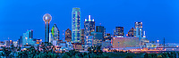 This is an panorama of the Dallas Skyline at twilight  or some say blue hour with only the light from the high rise skyscrapers in view in the downtown area. This cityscape has all the usual iconic dallas buildings like the Reuion Tower, Heritage Plaza, Fountain Place, Bank of America, to the alway colorful Omni Hotel in view.