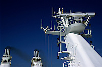Antennas and chimneys on a large ferry.