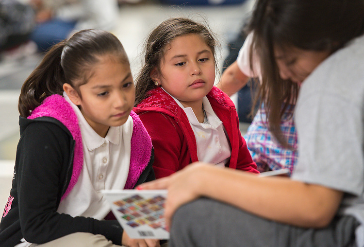 Members of the Davis High School National Honor Society read to students at Pugh Elementary School, November 18, 2014.