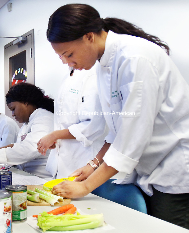 WATERBURY CT. 11 January 2015-011116SV02-Courtney Wade, 17, of Wilby High cuts up vegetables for chili during a Brass City Cooks cooking program for WIC recipients at the Health Department in Waterbury Monday. The Brass City Harvest started the program and they get help from the culinary students from Wilby. <br /> Steven Valenti Republican-American