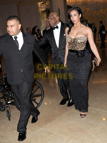 Mike Tyson leaving The 2014 Golden Globes held at The Beverly Hilton Hotel in Beverly Hills, California on January 12,2014.                                                                               <br /> CAP/DVS<br /> &copy;DVS/Capital Pictures