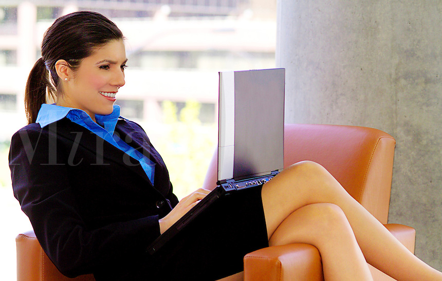 Beautiful woman working on laptop computer
