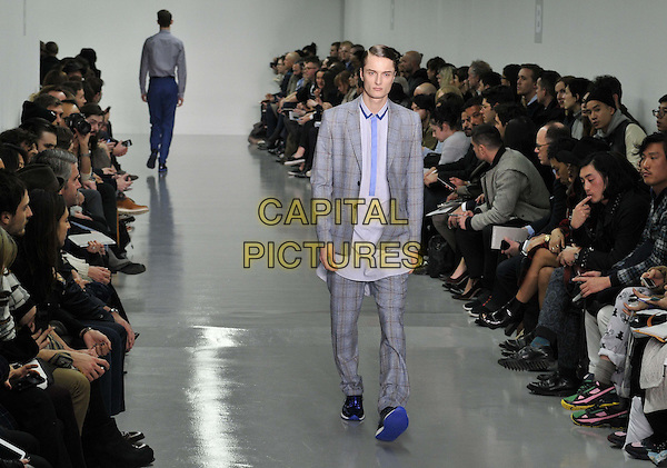 LONDON, ENGLAND - JANUARY 06: model on the runway at the Richard Nicoll catwalk show, London Collections: Men's ( LCM ) a/w 2014 season, BFC Showspace, Victoria House, Bloomsbury Place, on Monday January 06, 2014 in London, England, UK.<br /> CAP/CAN<br /> &copy;Can Nguyen/Capital Pictures